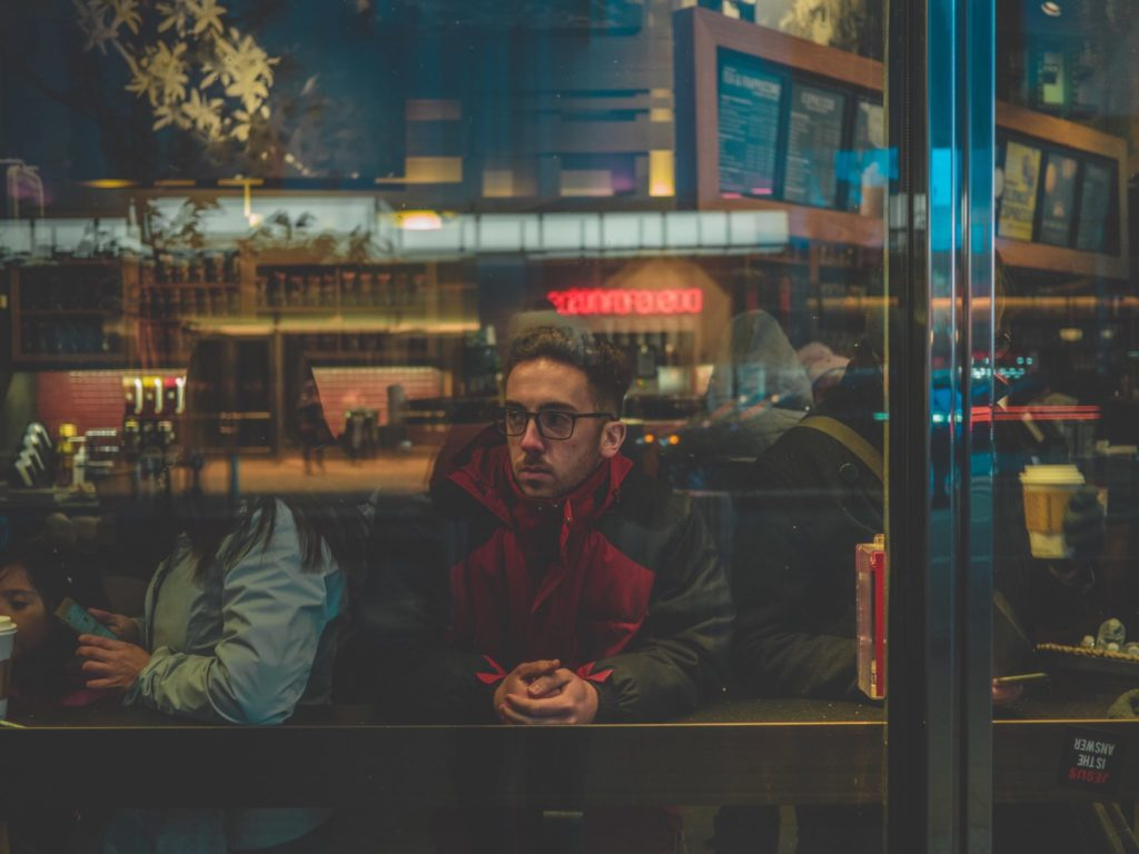 Disappointed Man in Window photo by Antonio Dicaterina on Conscious Life Space - Our Dissatisfaction with Ourselves