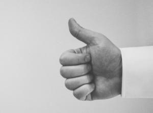 thumbs up - social media likes metaphor - conscious life guru