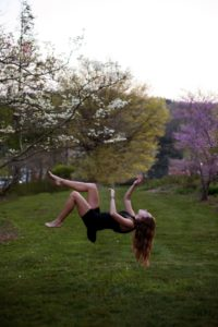 Young Woman Floating photo by Ashley Bean (CC0) Rites of Passage