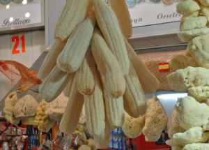 Sponges made of sponge gourd for sale alongside sponges of animal origin