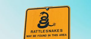 rattlesnake warning sign by Zach Savinar on Conscious Life Space