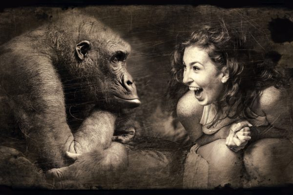 Woman and ape sitting together - photo art by Stefan Keller - Conscious Life Space