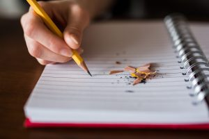 Writing in a notebook - Conscious Life Space