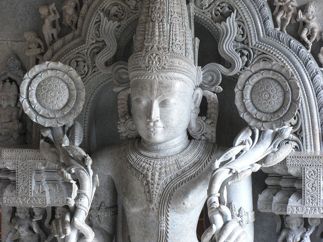 The solar deity Surya shown here as A wooden statue of Surya in New Delhi, India