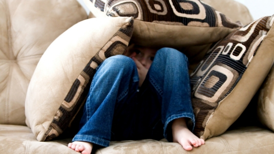 overcoming fear of discomfort - hiding under pillows and peering outward